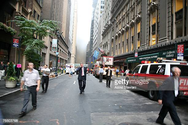 People walk away from a steam pipe explosion that occurred during rush hour in midtown Manhattan July 18 2007 in New York City Steam and mud were...