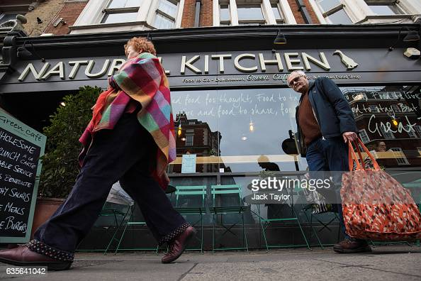 People walk by a a delicatessen and cafe in Marylebone on February 16 2017 in London England The Association for Licensed Multiple Retailers have...