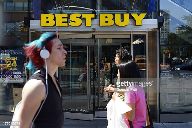 People walk by a Best Buy store on August 20 2013 in New York City Best Buy the electronics and entertainment retailer eported its secondquarter...