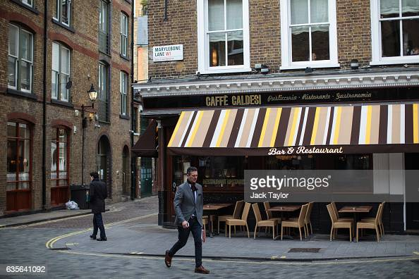 People walk by a Caffe Caldesi bar and restaurant in Marylebone on February 16 2017 in London England The Association for Licensed Multiple Retailers...