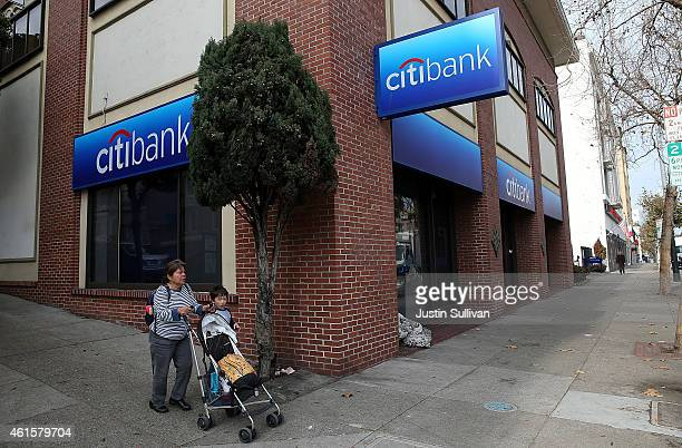 People walk by a Citibank branch office on January 15 2015 in San Francisco California Citigroup Inc reported an 86 percent decline in fourth quarter...
