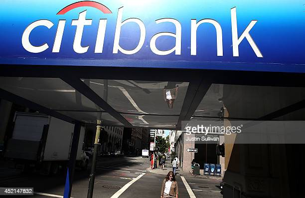 People walk by a Citibank branch office on July 14 2014 in San Francisco California After several months of negotiations with the US Department of...