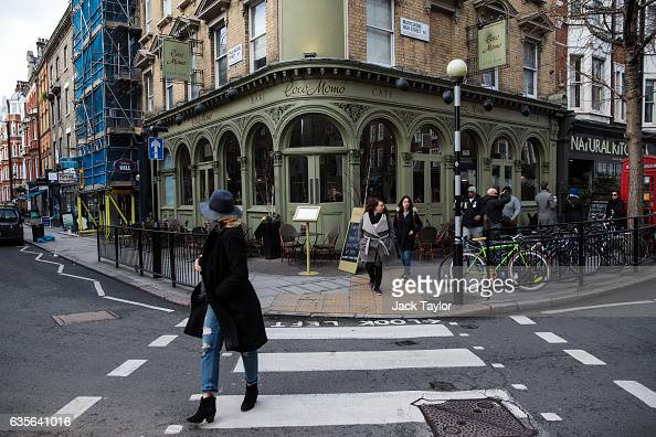 People walk by a Coco Momo restaurant in Marylebone on February 16 2017 in London England The Association for Licensed Multiple Retailers have...