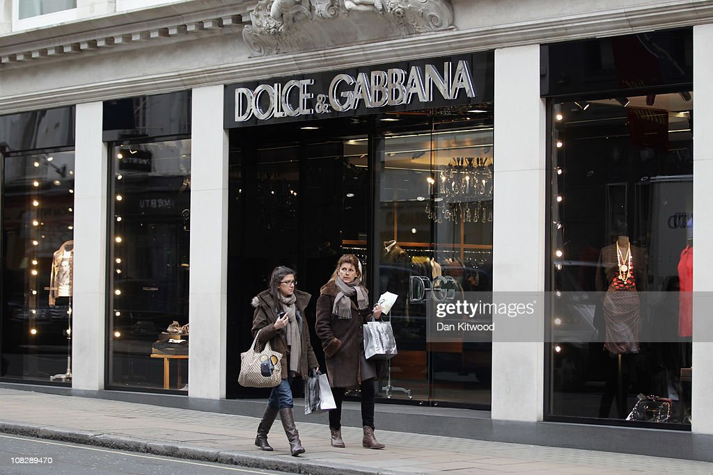 People walk by a Dolce Gabbana store window on Bond Street on January 24 2011 in London England Despite the expected retail slump sales of luxury...