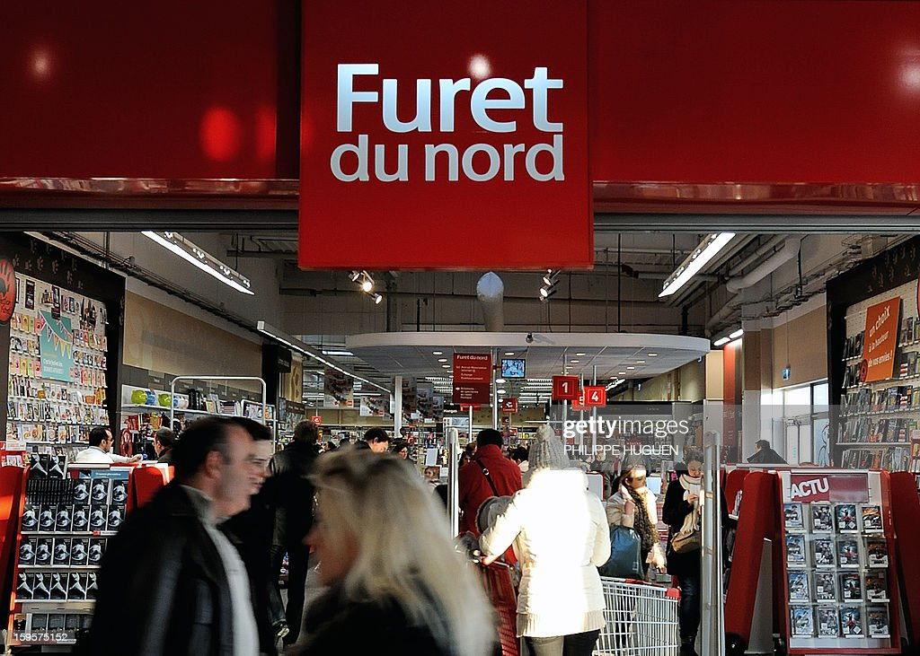People walk by a 'Furet du Nord' entertainment retailer store on January 16, 2013 in a mall in Englos, Northern France. Once owned by Butler Capital Partners like Virgin France that officially filed for bankruptcy last week, Furet du Nord, free from any financial group since 2008, is now expanding with four new stores opened between 2010 and 2012.