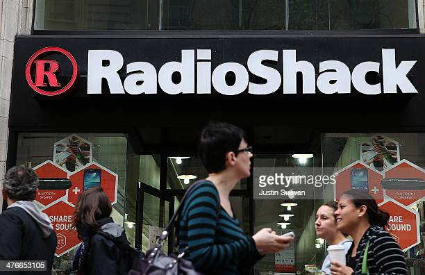 People walk by a Radio Shack store on March 4 2014 in San Francisco California RadioShack announced plans to close over 1000 of its underperforming...