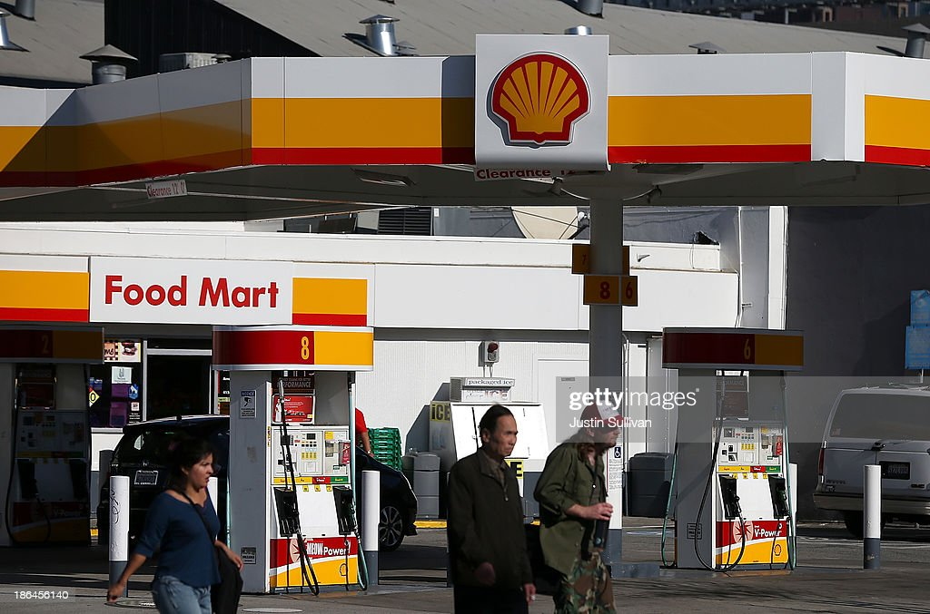People walk by a Shell gas station on October 31, 2013 in San Francisco, California. Royal Dutch Shell reported a 32% decline in third quarter profits with earnings of $4.5 billion compared to $6.5 billion one year ago.