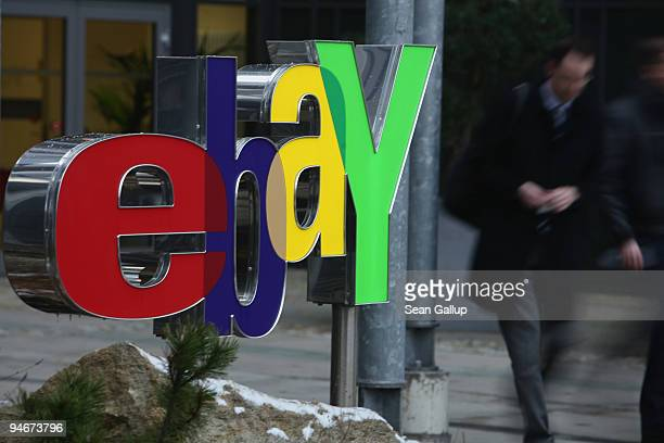People walk by a sign for Internet auction portal eBay at the eBay Germany headquarters on December 17 2009 in Kleinmachnow Germany The German...