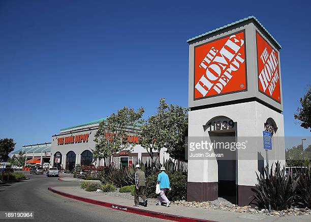 People walk by a sign in front of a Home Depot store on May 21 2013 in El Cerrito California Home Depot reported an 18 percent surge in first quarter...