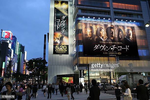 People walk by a Sony Building with billboards promoting 'The Da Vinci code' on May 18 2006 in Tokyo Japan The film directed by Ron Howard will open...