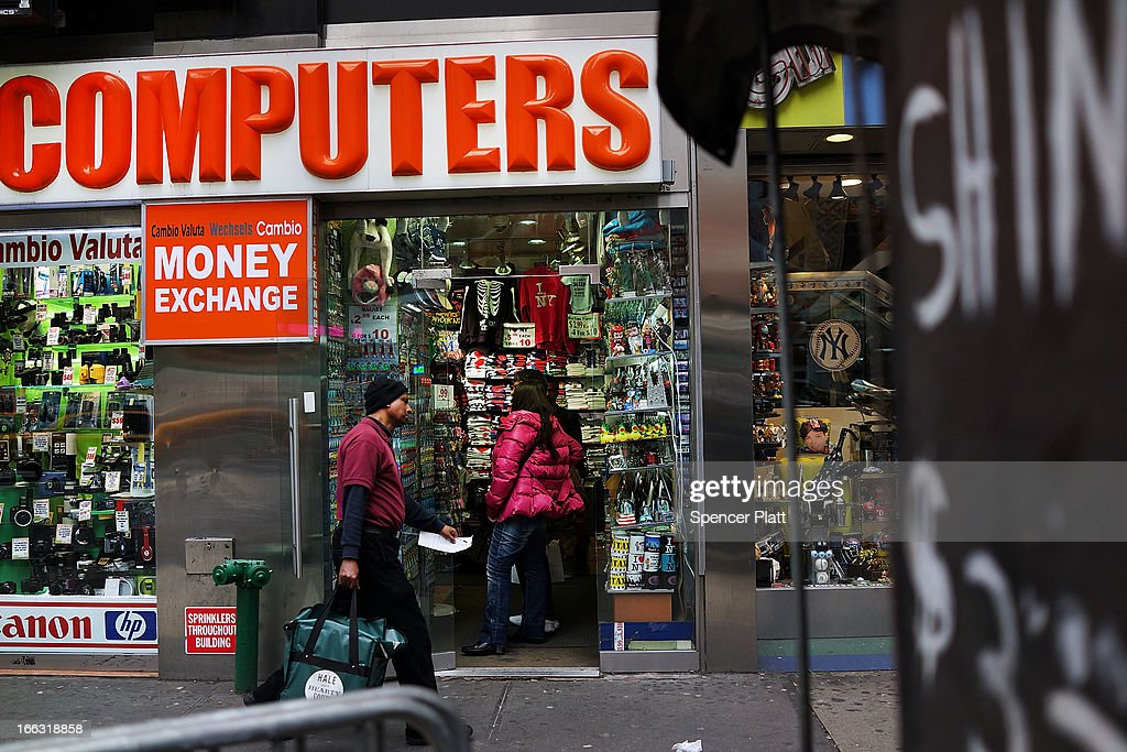 People walk by a store advertising personal computers (PC's) in Times Square on April 11, 2013 in New York City. Shipments of PCs fell 14% worldwide last quarter, sending shares of personal computer chipmakers, manufacturers and software companies sharply lower. As more people around the world turn to smart phones and tablets, PC sales had their worst quarter in history.