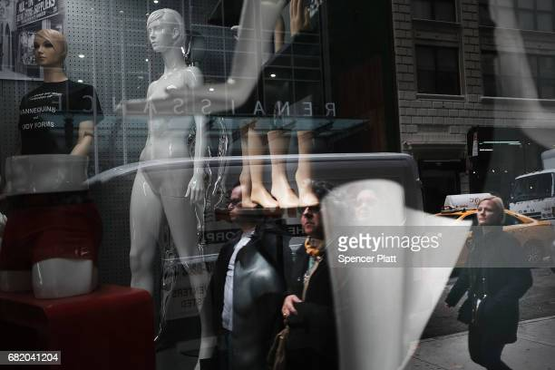 People walk by a store selling manichans in Manhattan's Garment District on May 11 2017 in New York City As the historic district shrinks New York...