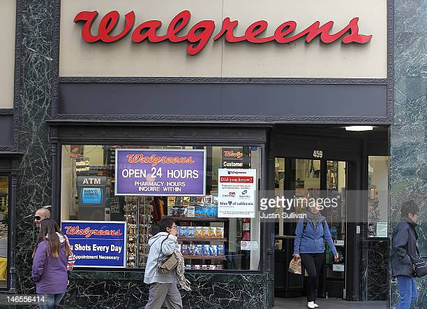 People walk by a Walgreens store on June 19 2012 in San Francisco California US based drug store chain Walgreens has announced a deal to purchase a...