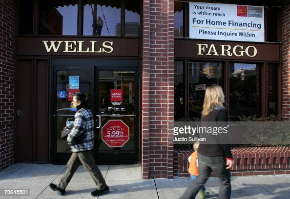 People walk by a Wells Fargo Home Mortgage branch office March 20 2007 in San Francisco California San Francisco based Wells Fargo Co announced today...
