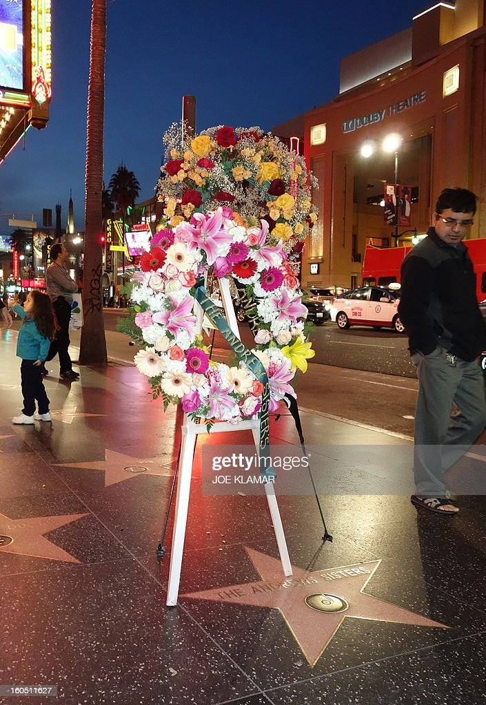 People walk by Andrews Sisters' Hollywood star decorated by wreaths and flowers at Hollywwod boulevard on February 01, 2013 in Hollywood ,California.Patty Andrews, the last of the Andrews Sisters, the jaunty vocal trio whose immensely popular music became part of the patriotic fabric of World War II America, died on Wednesday at her home in Los Angeles. She was 94.