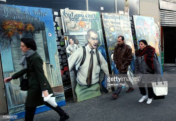 People walk by art work inspired by September 11 in front of Ninos restaurant February 8 2002 in New York City Within 24 hours of the terrorist...