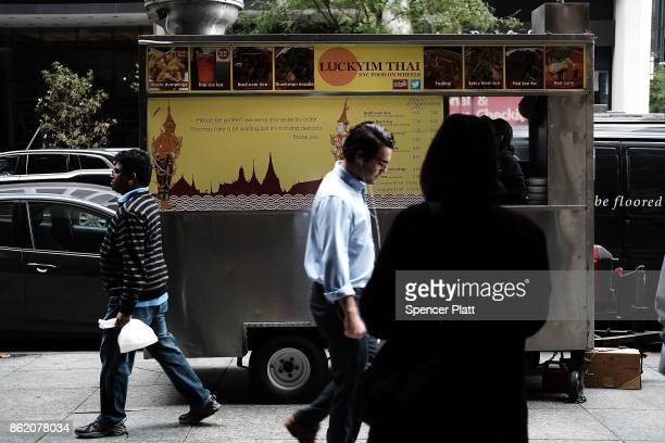 People walk by food carts selling food from a variety of countries on October 16 2017 in New York City The US Department of Justice has claimed that...
