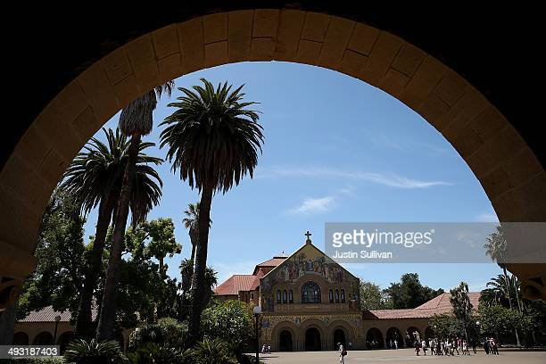 People walk by Memorial Church on the Stanford University campus on May 22 2014 in Stanford California According to the Academic Ranking of World...