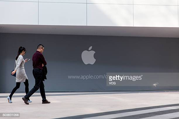 People walk by SM Lifestyle Center where the next Apple Store in China mainland will open on January 7 2016 in Xiamen Fujian Province of China The...