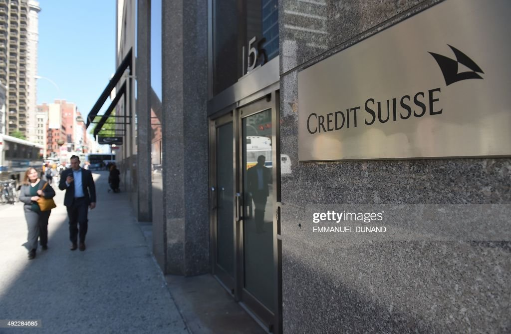 People walk by Swiss bank Credit Suisse headquarters in New York May 19 2014 Credit Suisse Switzerlands secondlargest bank is poised later today to...
