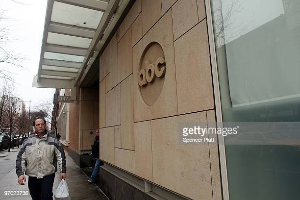 People walk by the ABC headquarters on February 24 2010 in New York New York ABC has announced that the television news division plans to cut 2025...