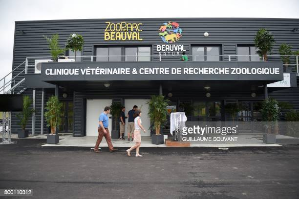 People walk by the building of the new veterinary clinic at the Zooparc of Beauval in SaintAignansurCheron June 23 2017 The Beauval zoo inaugurated...