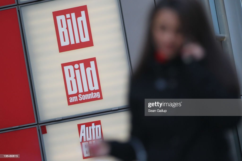 People walk by the editorial offices of Bild Zeitung, Germany's biggest tabloid newspaper, at Axel Springer Verlag publishing house corporate headquarters on January 6, 2011 in Berlin, Germany. Bild Zeitung Editor-in-Chief Kai Diekmann and German President Chistian Wulff are locked into a war of words over a message Wulff left on Diekmann's mobile phone in which he reportedly demanded that Bild not publish a compromising story about Wulff's personal financial conduct while governor of Lower Saxony. In a recent television interview Wulff claimed he only asked Diekmann to postpone publication of the story by a day.