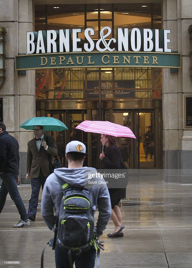 People walk by the entrance to a Barnes & Noble store on April 30, 2012 in Chicago, Illinois. Barnes & Noble plans to spin off its digital business, which includes its Nook e-reader, and partner with Microsoft and to form a new business called Newco. With a $300 million investment, Microsoft Inc. will own a 17.6 percent stake in the new unit.