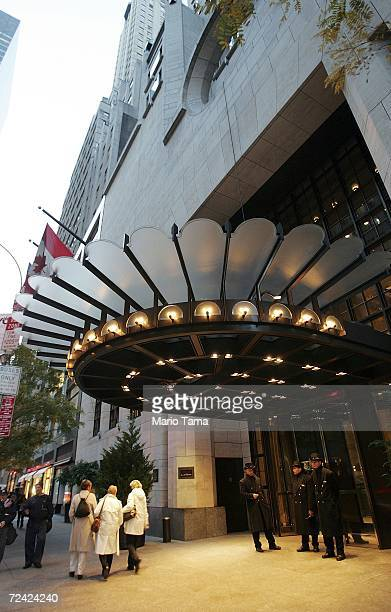 People walk by the Four Seasons Hotel on November 6 2006 in New York City The hotel chain has received a $37 billion buyout offer from a group...