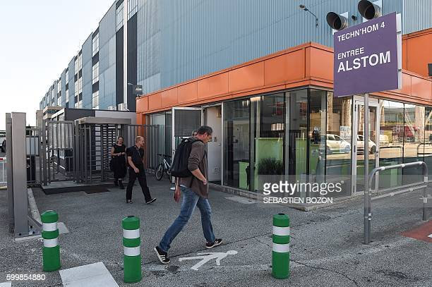 People walk by the French power and transport engineering company Alstom factory in Belfort on September 7 2016 French rail transport manufacturer...