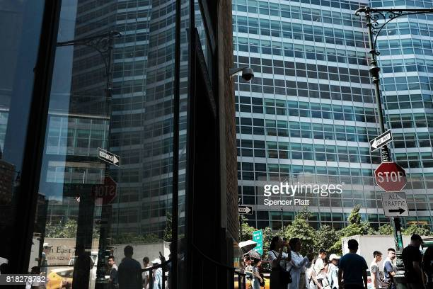 People walk by the Goldman Sach's New York headquarters on July 18 2017 in New York City Goldman Sachs Group Inc reported on Tuesday a 40 percent...
