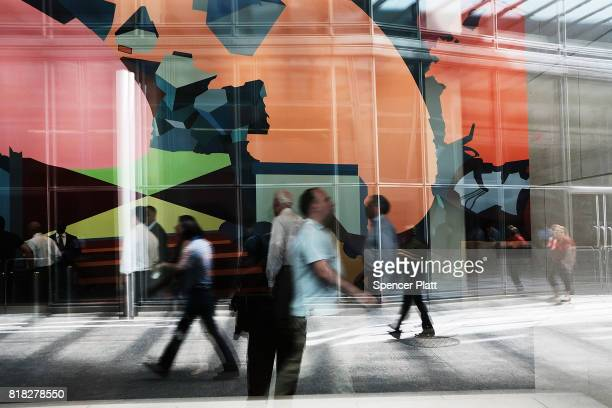 People walk by the lobby of Goldman Sach's New York headquarters on July 18 2017 in New York City Goldman Sachs Group Inc reported on Tuesday a 40...