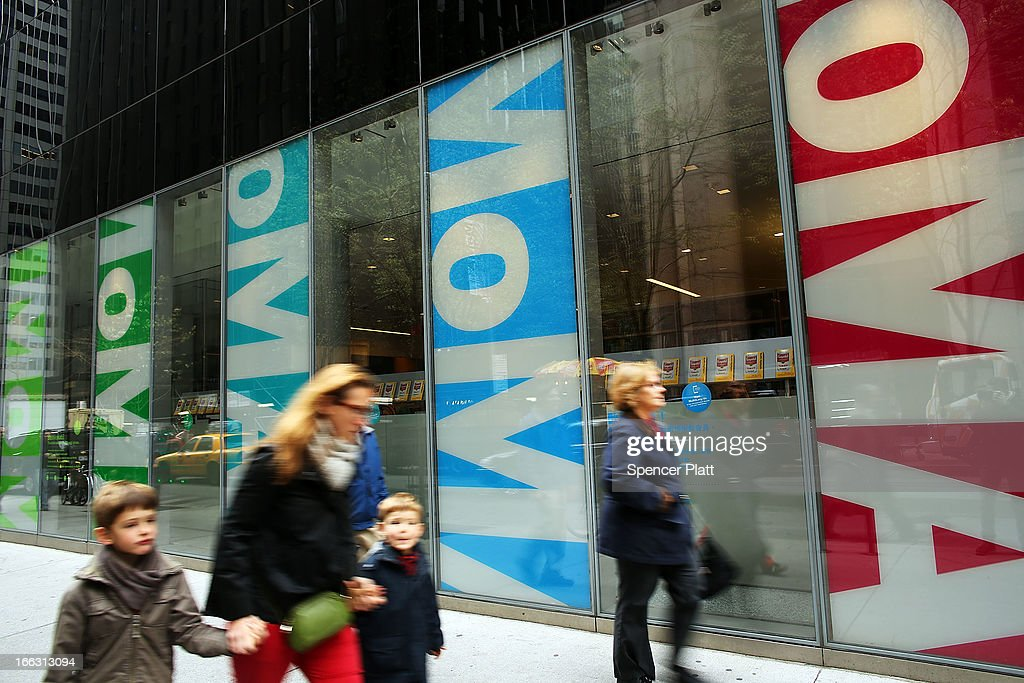 People walk by the Museum of Modern Art on April 11 2013 in New York City MoMA announced yesterday that it will demolish the former Museum of...