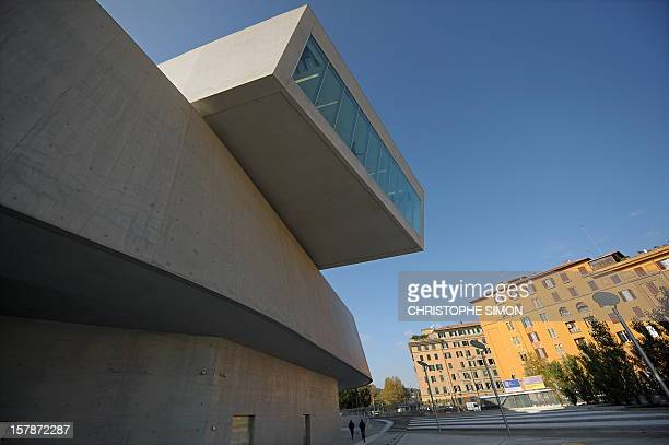 People walk by the National Museum of the XXI Century Arts the Maxxi during the architectural preview on the occasion of the completion of the...