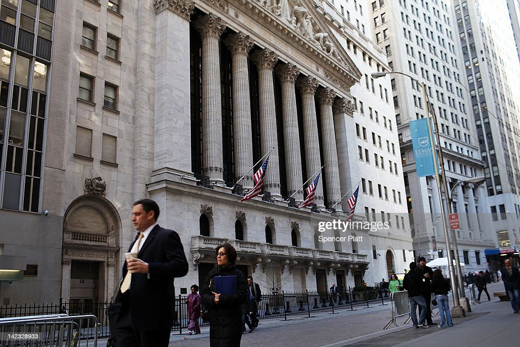 People walk by the New York Stock Exchange on April 2, 2012 in New York City. In the first trading day of April, U.S. stocks opened the second quarter with limited gains with the Dow Jones Industrial Average added 37.95 points to 13,249 in morning trading.