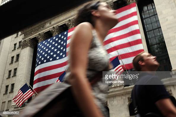 People walk by the New York Stock Exchange on September 4 2015 in New York City The Dow Jones industrial average finished the day down over 250...