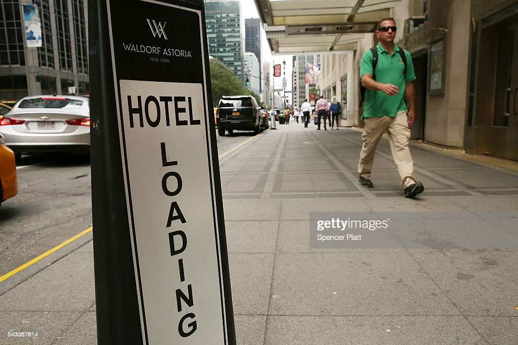 People walk by the New York's landmark Waldorf Astoria Hotel on June 27, 2016 in New York City. China's Anbang Insurance Group, which recently purchased the Waldorf from Hilton Worldwide Holdings in 2014 for $1.95 billion, has announced plans to convert as much as three-quarters of the rooms into apartments. The insurer will close the Waldorf for up to three years starting next spring for the renovation.