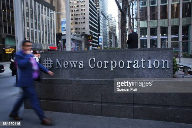 People walk by the News Corporation headquarters owner of Fox News on April 5 2017 in New York City Following allegations that he sexually harassed...