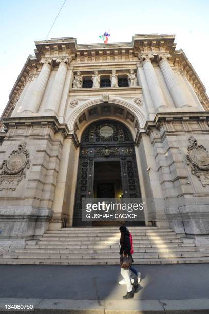 People walk by the offices of the Bank of Italy in Milan on November 25 2011 The Bank of Italy was forced to pay recordhigh rates the same day in a...