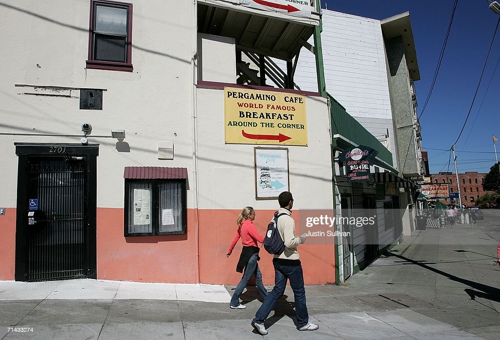People walk by the proposed site of the Green Cross medical marijuana dispensary July 13, 2006 in San Francisco. San Francisco city planners are deciding July 13 if they will issue a permit to allow Kevin Reed to open the Green Cross medical marijuana dispensary right in the middle of San Francisco's Fisherman's Wharf area, a popular tourist destination.