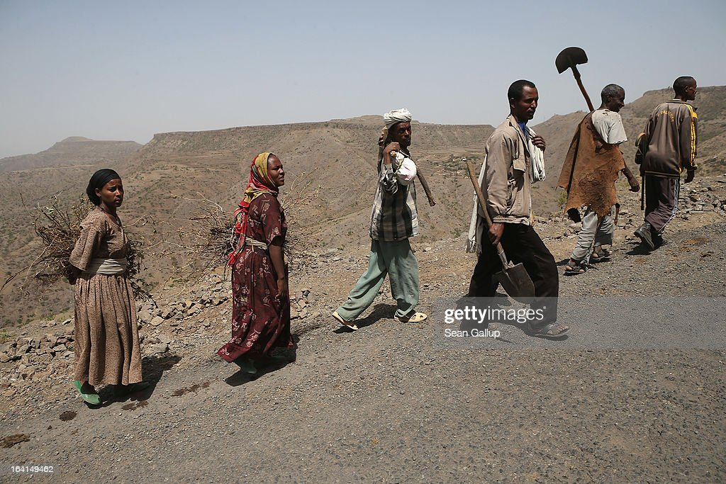 People walk by the side of the road in the Lasta mountain range on March 19, 2013 near Lalibela, Ethiopia. Ethiopia, with an estimated 91 million inhabitants, is the second most populated country in Africa and the per capita income is $1,200.