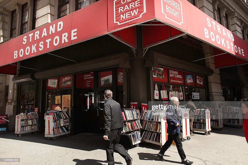 People walk by the Strand Bookstore on April 2, 2012 in New York City. Workers and owners of the Strand are in a contract dispute over healthcare contributions, a two-tier wage system and other benefits. Part of the United Autoworker's Union, the store's 140 non-management employees will vote on a new contract this week.