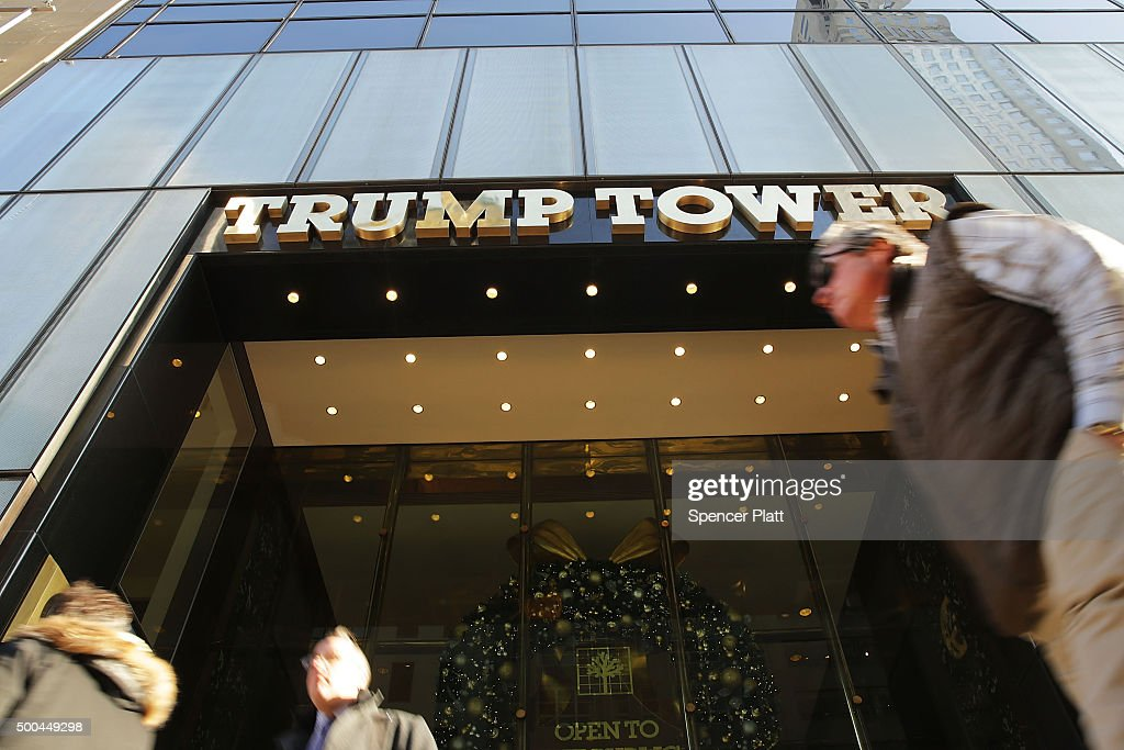 People walk by the Trump Tower in Midtown Manhattan on December 8 2015 in New York City Donald Trumps latest incendiary remarks concerning Muslims...