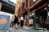 People walk down a popular shopping street in Dumbo on October 4 2013 in the Brooklyn borough of New York City A group of five prominent properties...