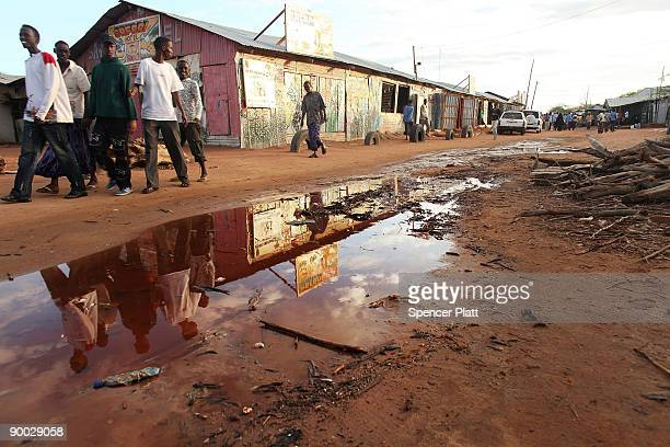 People walk down a street in the world's biggest refugee complex August 23 2009 in Dadaab Kenya The Dadaab refugee complex in northeastern Kenya...