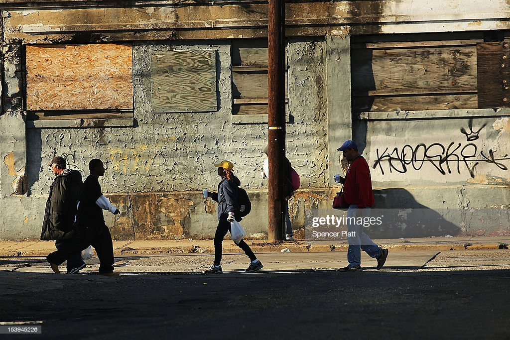 People walk down a street on October 11 2012 in Camden New Jersey According to the US Census Bureau Camden New Jersey is now the most impoverished...