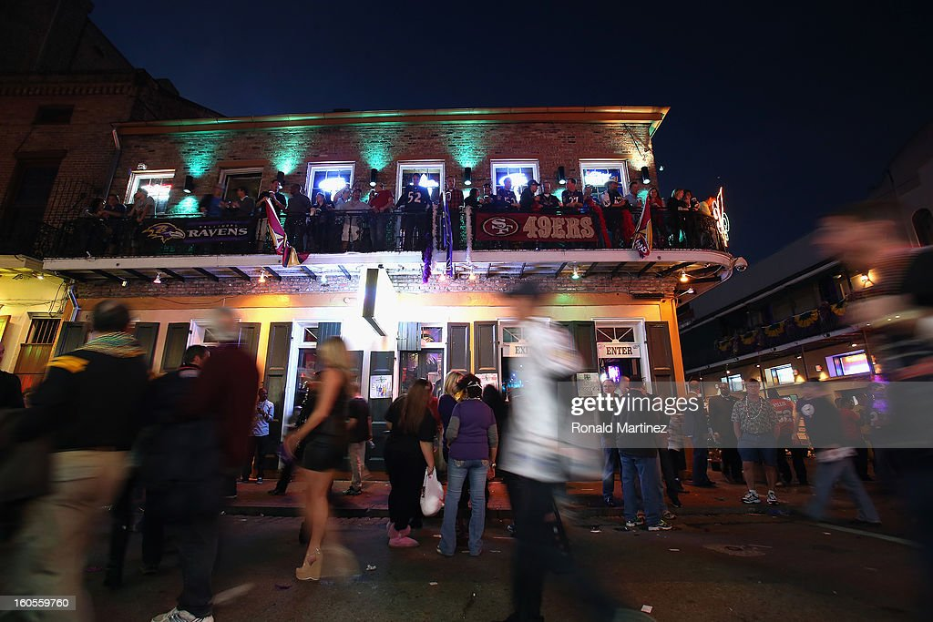 People walk down Bouborn Street prior to Super Bowl XLVII on February 2, 2013 in New Orleans, Louisiana.