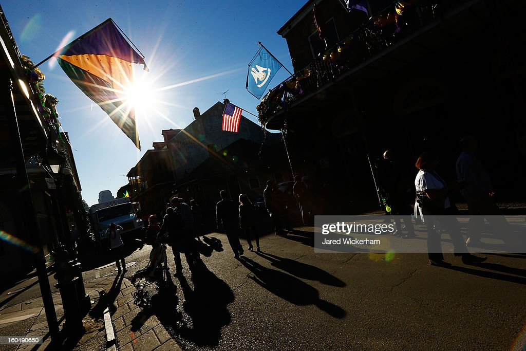 People walk down Bourbon Street prior to Super Bowl XLVII on February 1, 2013 in New Orleans, Louisiana.