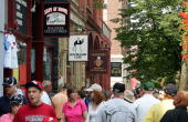 People walk down main street in Cooperstown before the Baseball Hall of Fame induction ceremony on July 27 2008 in Cooperstown New York