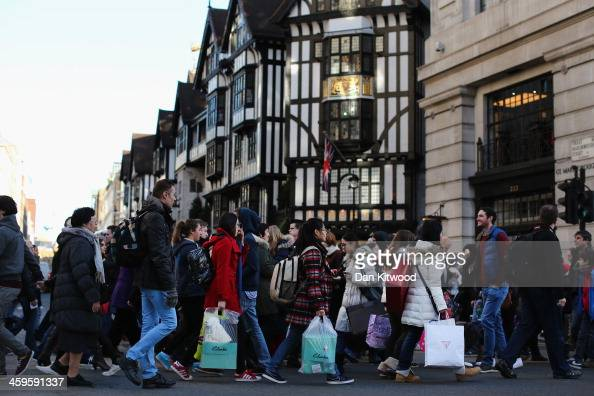 People walk down Regent Street on December 28 2013 in London England Shoppers across the country are reemerging to take advantage of the post...